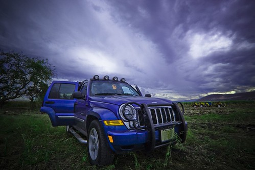 SUV and threatening sky, By Shuck