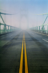 the line that leads to the places you'll go (manyfires) Tags: road bridge film fog oregon portland pentaxk1000 pacificnorthwest pdx stjohnsbridge