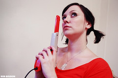 Ali & Nintendo Zapper - 7/21/05 (Rob Boudon) Tags: orange nintendo ali pigtails alison zapper lightgun lammy robboudonphotography 118thstreet spanishharlemapartment