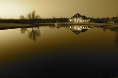 Sepia House on Pond (sunsurfr) Tags: sunset house reflection tree nature monochrome sepia lights pond alabama explore d200 effect nikonstunninggallery anawesomeshot superaplus aplusphoto sunsurfr