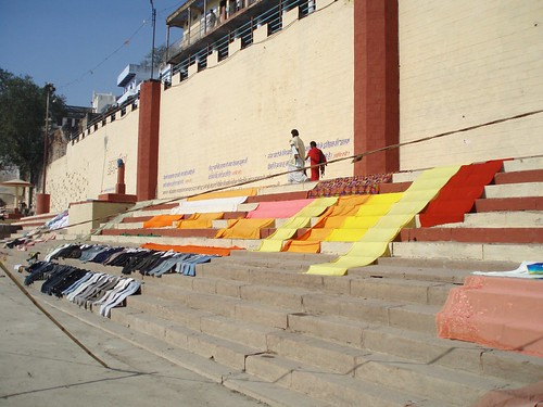 saris hung out over varanasi ghat' stairs