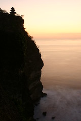 tinggi (Farl) Tags: longexposure travel sunset sea bali cliff colors indonesia temple twilight surf waves dusk horizon religion indianocean uluwatu hinduism uncropped jimbaran unprocessed