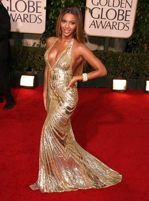 Beyonce con vestido dorado
