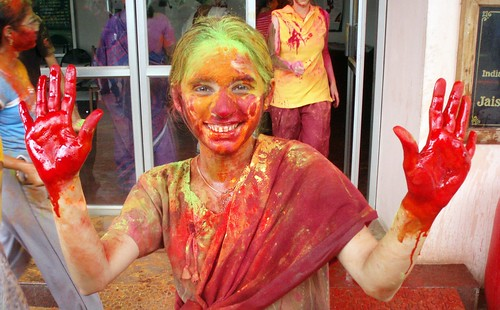 IIt girl during holi festival, red hands