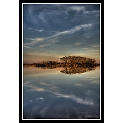 Arrowhead Reflection (sunsurfr) Tags: blue trees sunset sky reflection tree beach water glass clouds island mirror coast woods bravo antique alabama coastline d200 arrowhead hdr gulfshores photomatrix nikonstunninggallery nikonstunning abigfave gulfshorestriphdrfortmorgan sunsurfr