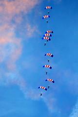 falling from the sky (Linda Cronin) Tags: pink blue red sky cloud white air thumbsup raf parachute bigginhill flickrsbest cy2 challengeyouwinner 3waychallengewinner cywinner colorphotoaward faceoffwinner 15challengeswinner lindacronin motifdchallengewinner photofaceoffwinner a3b goldstaraward friendlychallenges friendlycomments pregamewinner