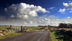 On The Road Again (Scott Foy) Tags: road trees sky wall clouds canon fence scotland gate quality fields renfrewshire howwood magicdonkey outstandingshots 400d abigfave scottfoy anawesomeshot impressedbeauty superaplus aplusphoto superbmasterpiece goldenphotographer