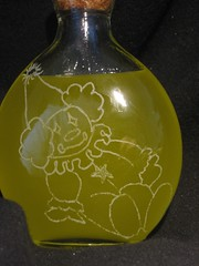 Clown Bottle with Massage Oil - close-up