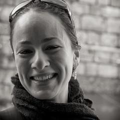 Vivacious young lady (gyuri200) Tags: snapshot marketplace lively animated smile bw portrait