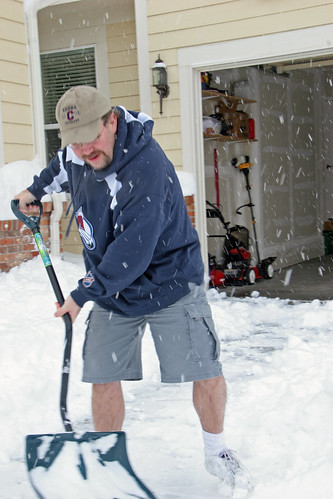 Leif shoveling snow in his shorts