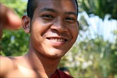 Khmer Smile: Cham Reourn (mboogiedown) Tags: world travel friends smile hope pagoda asia cambodia cambodian bokeh robe buddhist south faith religion nation belief monk buddhism east southeast cham monastic developing kampuchea cambogia theravada khmersmile travelforpeace camboge soksabay beatravelernotatourist itsallaboutthepeople reasontolearnkhmer peopleiwillneverforget reourn ifthephotographerisinterestedinthepeopleinfrontofhislensandifheiscompassionateitsalreadyalottheinstrumentisnotthecamerabutthephotographerevaarnold