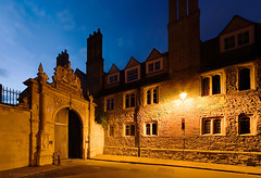 Nevile's Gate in Trinity Lane (. Andrew Dunn .) Tags: uk cambridge england brick lamp stone wall architecture gate cityscape britain dusk columns convergence trinitycollegecambridge trinitylane interestingness315 i500 outstandingshots challengeyouwinner nevilesgate crossoverlighting
