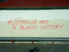 Not everybody celebrated Australia Day (badjonni) Tags: red urban white black colour history wall graffiti colorful paint aborigine