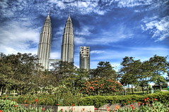 The Tallest Buildings in the World (well, until 2004) (Stuck in Customs) Tags: park flowers blue summer sky sun green architecture kids buildings garden photography high nikon day cityscape photographer skyscrapers awesome petronas towers malaysia kualalumpur hdr klcc petronastowers highquality rayes stuckincustoms treyratcliff