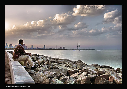 City meditation (khalid almasoud) city light sun 3 man clouds canon eos seaside rocks towers 9 24 meditation kuwait 105 khalid 2007 xti 400d almasoud