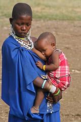 Maasai mother breastfeeding baby (imanh) Tags: africa blue woman baby color tanzania blauw breast child mother kind afrika breastfeeding massai moeder maasai vrouw iman kleur borst borstvoeding heijboer masa imanh