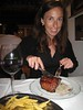 Julee with half an Agentine Steak.  La Brigada Restaurant Buenos Aires