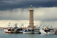 the Lighthouse in double sky.. (Liv ) Tags: travel blue sea 2 sky people italy lighthouse 3 topf25 tag3 by 1 photo interestingness italian tag2 italia colours tag1 blu tag ivan double explore 09 planet puglia bari nationalgeographic apulia lazzari molfetta topf550 laiv nikond80 p1f1 pugliaitaly impressedbeauty superaplus aplusphoto wowiekazowie laivphoto nikonvr70300 potwkkc31 gmodules