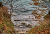 On the Beach (gabi-h) Tags: sandbanks sandbanksprovincalpark water waves beach leaves gabih view landscape rocks branches shoreline lakeontario