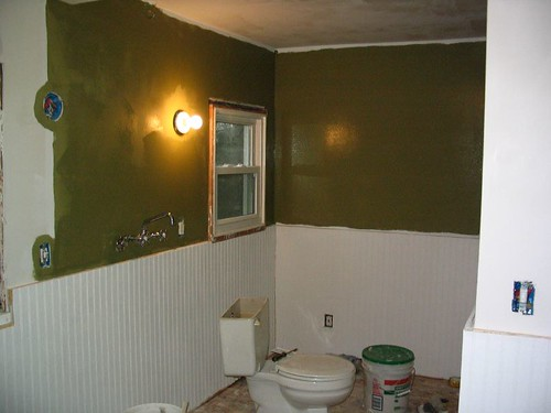 Bathroom with first coat of green paint
