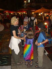 Hill Tribe woman gives the family the shakedown at the night Market