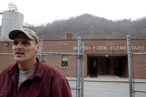 Ed Wiley in front of Marsh Fork elementary, photo by Kent Kessinger