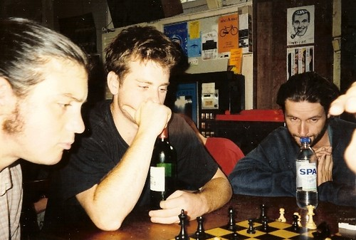 Bill plays chess in a hostel in Amsterdam