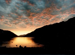 Lake Crescent sunset (kevin dooley) Tags: eve sunset lakecrescent orange sun lake water washington dusk crescent explore reflectedlight 25faves abigfave aplusphoto excapture