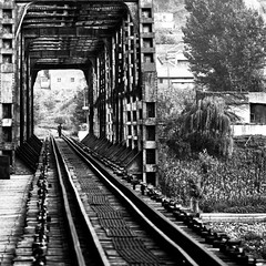 off the rails (GraemeNicol) Tags: china bridge bw river soldier army asia guard perspective rail security korea communism jian northkorea dprk jilin yalu koguryo gaogouli