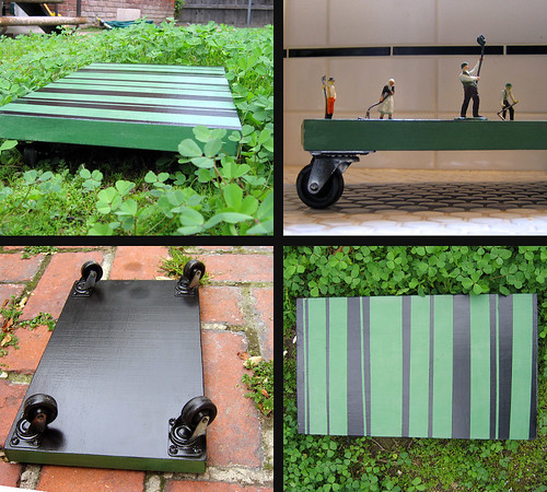 Green and black striped wheeled desktop dolly