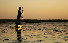 Okavango Delta, Botswana (elosoenpersona) Tags: africa park sunset reflection nature rio river atardecer boat nikon d70 wildlife safari national reflejo botswana mokoro okavango supershot 10faves mekoro abigfave superbmasterpiece elosoenpersona theperfectphotographer