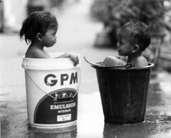 two types of street bath (richard thomson) Tags: street blackandwhite bw night children bucket nikon bath paint 85mm 35mmfilm baths laos bathtime topf100 luangprabang emulsion nikonfe2 top20street louangphabang bwart1day lpwater2