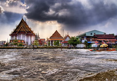 Afternoon in Bangkok (Stuck in Customs) Tags: houses rescue nature water clouds river thailand temple photography boat nikon photographer flood bangkok buddha buddhist religion 911 poor help temples sos smokes drama hdr floods catastrophe phenomenon highquality oustanding stuckincustoms treyratcliff catastrophenaturelle focuspocus2