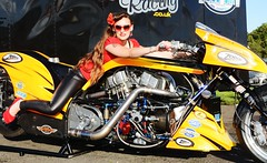 Holly_9895 (Fast an' Bulbous) Tags: supertwin nitro veetwin harleydavidson top fuel bike motorcycle biker chick babe girl woman hot sexy sunglasses long brunette hair legs red shoes high heels stilettos tight leather jeans pvc leggings model pose pinup people outdoor nikon drag santa pod england race track strip pits