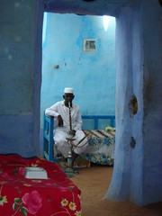 Relaxing as tourist explore his home - man in nubian village