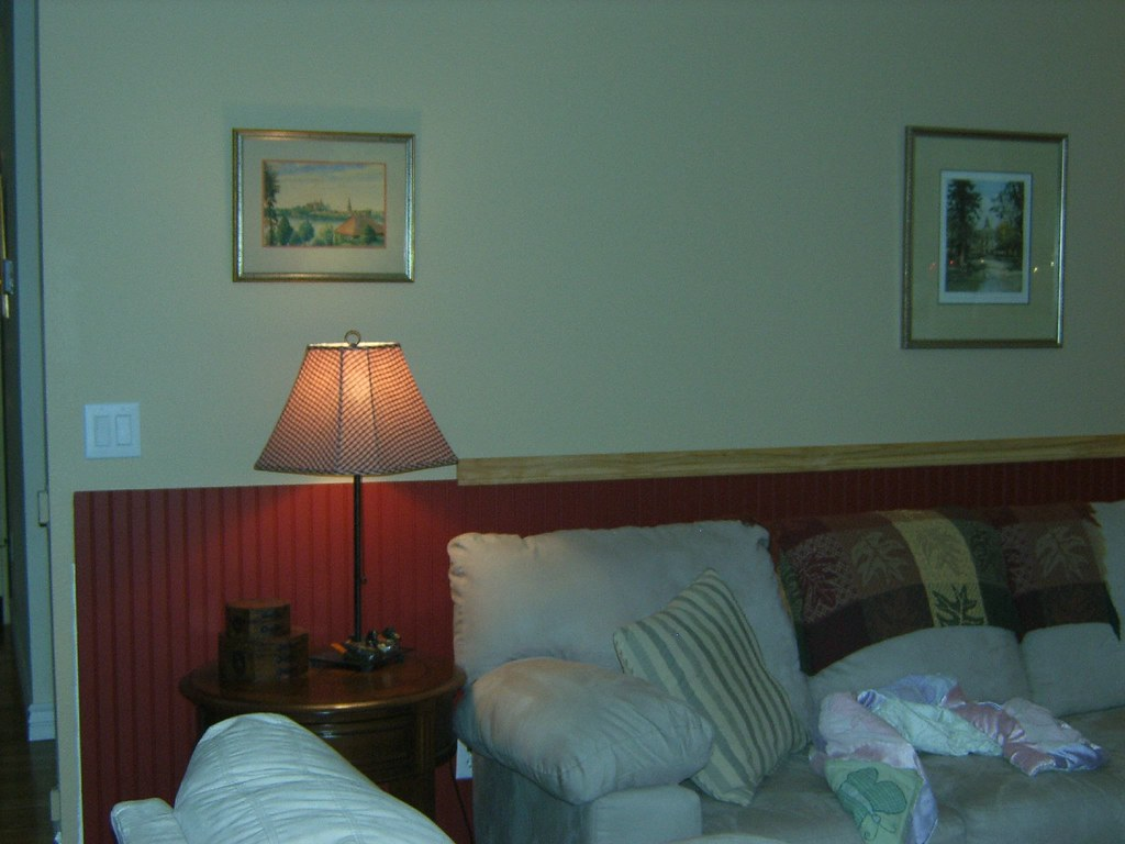 The newly painted wall and new wainscotting