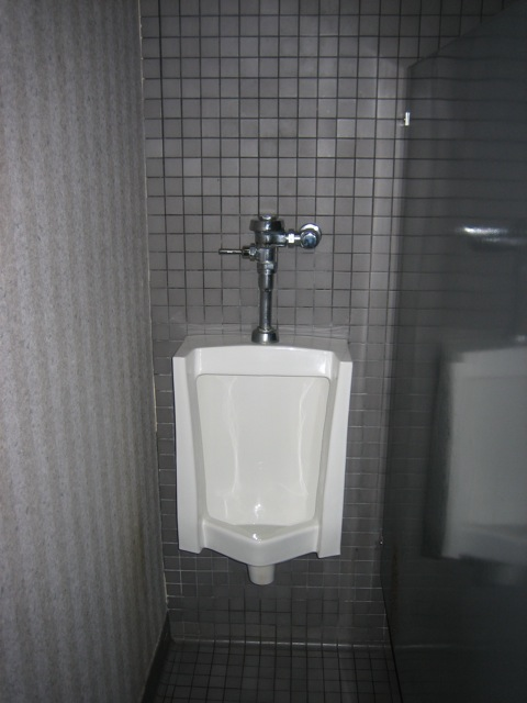 Urinal in a narrow space