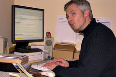 Photo of Ben in front of his computer while editing a Google Docs documment