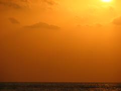 and another yellow sunset. (shahmurai) Tags: pakistan sunset sea sun beach yellow clouds