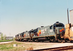 Early CSX Transportation Company train with former Seaboard System locomotives. Hayford Junction. Chicago Illinois. July 1989.