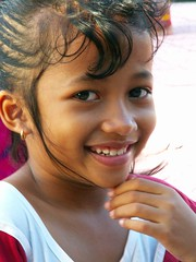 Child on Kuta beach (Franc Le Blanc .) Tags: portrait bali beach girl beautiful smile indonesia asia lovely breathtaking pantai kuta excellence theface yougotit anakanak plus4 passionphotography plus4excellence invitedphotosonlyplus4 ysplix flickrphotoaward portraitworld