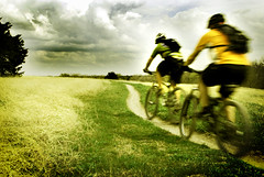 Riders On The Storm (Wade Griffith) Tags: storm color bike clouds speed lomo texas action explore trail motionblur mountainbiking camelback mckinney riders erwinpark wadegriffith nikond80 wadegriffith2010