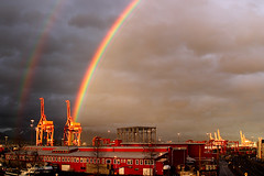 double happiness (♫ marc_l'esperance) Tags: light red sky color colour colors vancouver contrast port canon dark eos intense rainbow dock raw colours cloudy © double cranes warehouse 10d shipyard doublerainbow brilliant brightness allrightsreserved 2007 cml gvrd canonef24mmf28