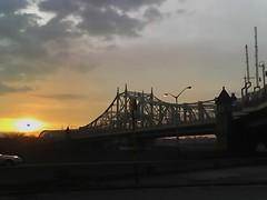 NYC Sunrise (PunkElmo) Tags: cameraphone nyc bridge sunrise moblog harlem guesswherenyc motorola nycguessed v551 onlyinnewyork outsidemyapartment macombsdambridge geogguessed