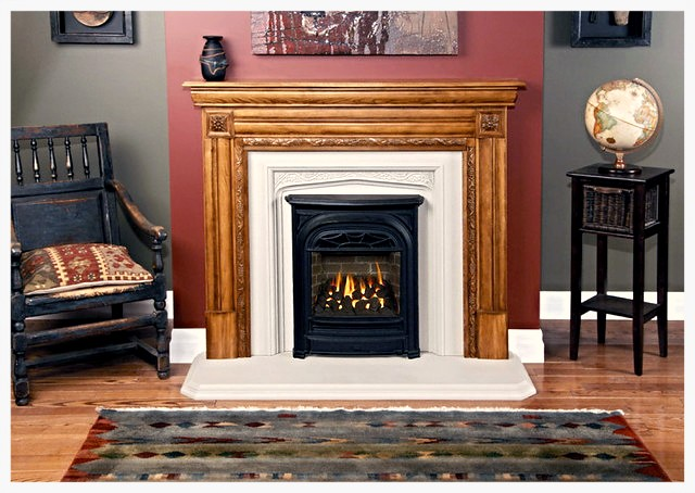 KINGSTON  The hand carved   floral corner blocks and deeply sculpted grape and vine pattern trim the opening of the Kingston mantel. This mantel works particularly well with the Gothic arched Tudor Vine backpanel and matching hearth. These mantels are ava