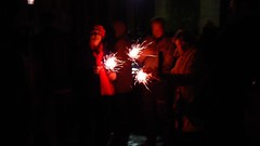 French family lighting sparklers