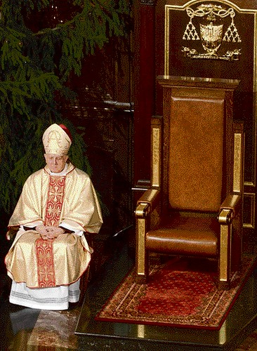 Warsaw's new archbishop Stanislaw Wielgus sits beside the empty throne in St John's Cathedral, during a Mass in Warsaw, Poland, Sunday, Jan. 7, 2007. Wielgus resigned Sunday amid a scandal over his involvement with the communist-era secret police. Wielgus announced his decision at the Cathedral, packed with worshippers gathered for a Mass that was to have marked his formal installation.  (AP Photo/ Alik Keplicz)