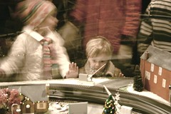 awe (Farl) Tags: christmas nyc newyorkcity travel ny newyork motion colors station speed train us child display manhattan transport central grand exhibition midtown polarexpress innocence grandcentralstation mta desaturated amazement awe grandcentral firsttheearth