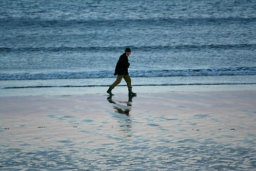 man striding on beach at St Andrews