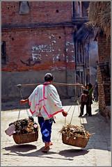 Children (Katarina 2353) Tags: street travel nepal woman film analog photography nikon asia cityscape republic image symmetry federal democratic carry bhaktapur nikonf401s katarinastefanovic katarina2353